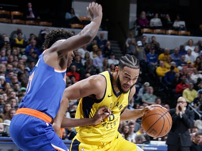 INDIANAPOLIS, IN - DECEMBER 16: Cory Joseph #6 of the Indiana Pacers drives to the basket against the New York Knicks on December 16, 2018 at Bankers Life Fieldhouse in Indianapolis, Indiana.