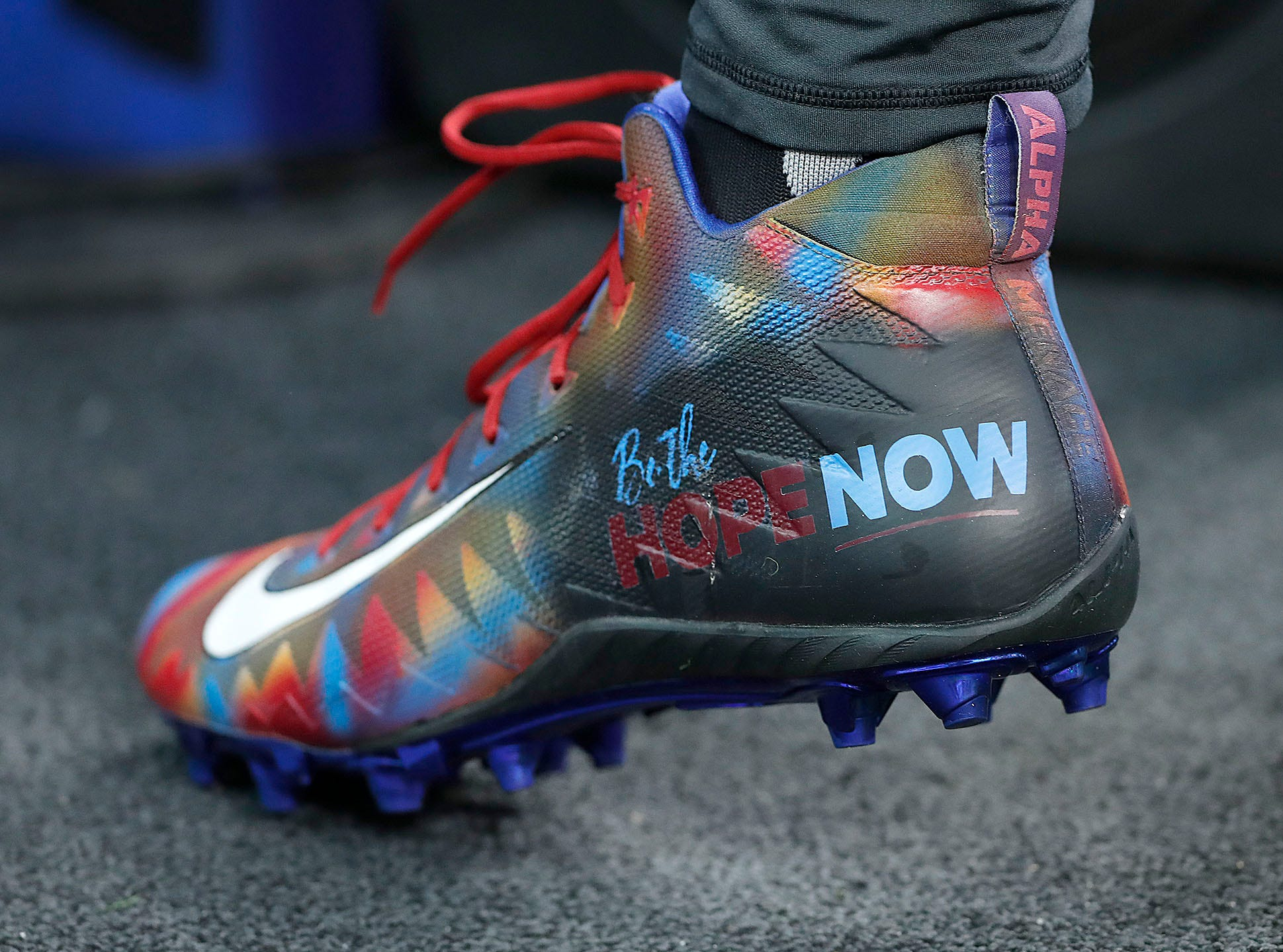 Indianapolis Colts quarterback Andrew Luck (12) and his My Cleats, My Cause before the start of their game against the Dallas Cowboys at Lucas Oil Stadium on Sunday, Dec. 16, 2018.
