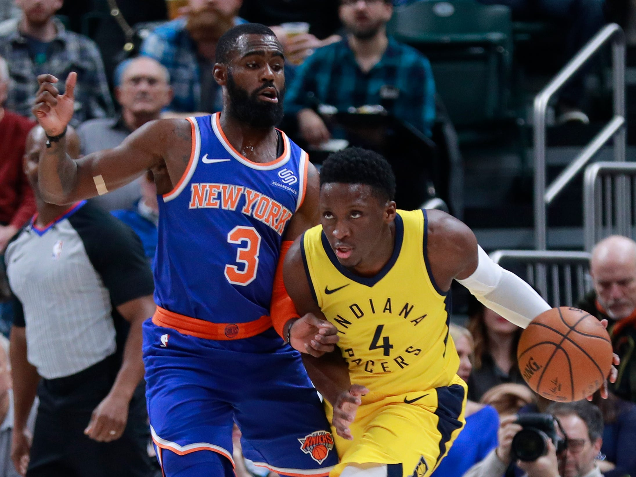 Indiana Pacers guard Victor Oladipo (4) dribbles the basketball defended by New York Knicks guard Tim Hardaway Jr. during the first half of an NBA basketball game, Sunday, Dec. 16, 2018, in Indianapolis.
