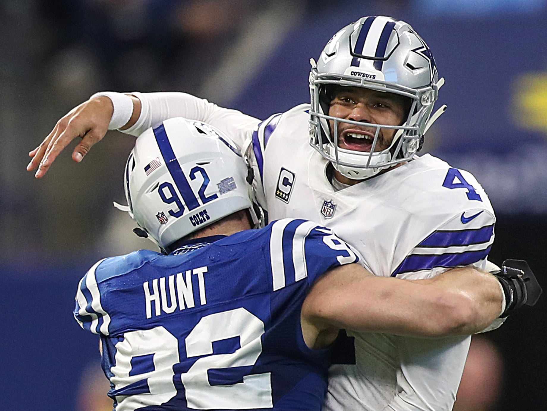 Indianapolis Colts defensive end Margus Hunt (92) pressured Dallas Cowboys quarterback Dak Prescott (4) to get rid of the ball in the second half of the game at Lucas Oil Stadium in Indianapolis, Sunday, Dec. 16, 2018.
