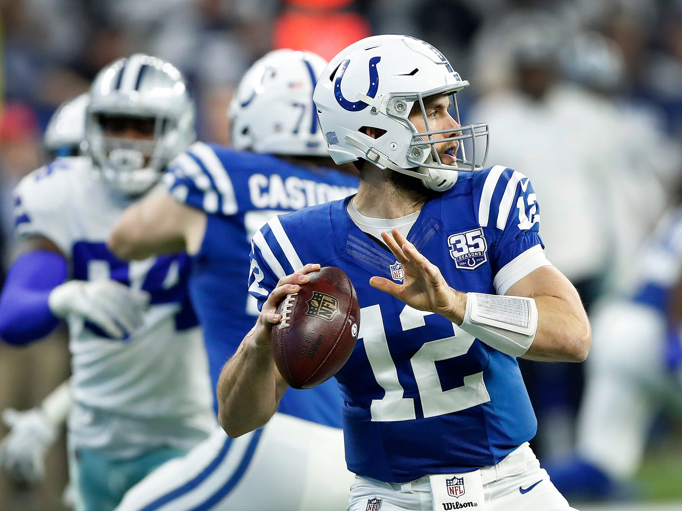 Indianapolis Colts quarterback Andrew Luck (12) drops back to pass in the first half of their game at Lucas Oil Stadium on Sunday, Dec. 16, 2018.