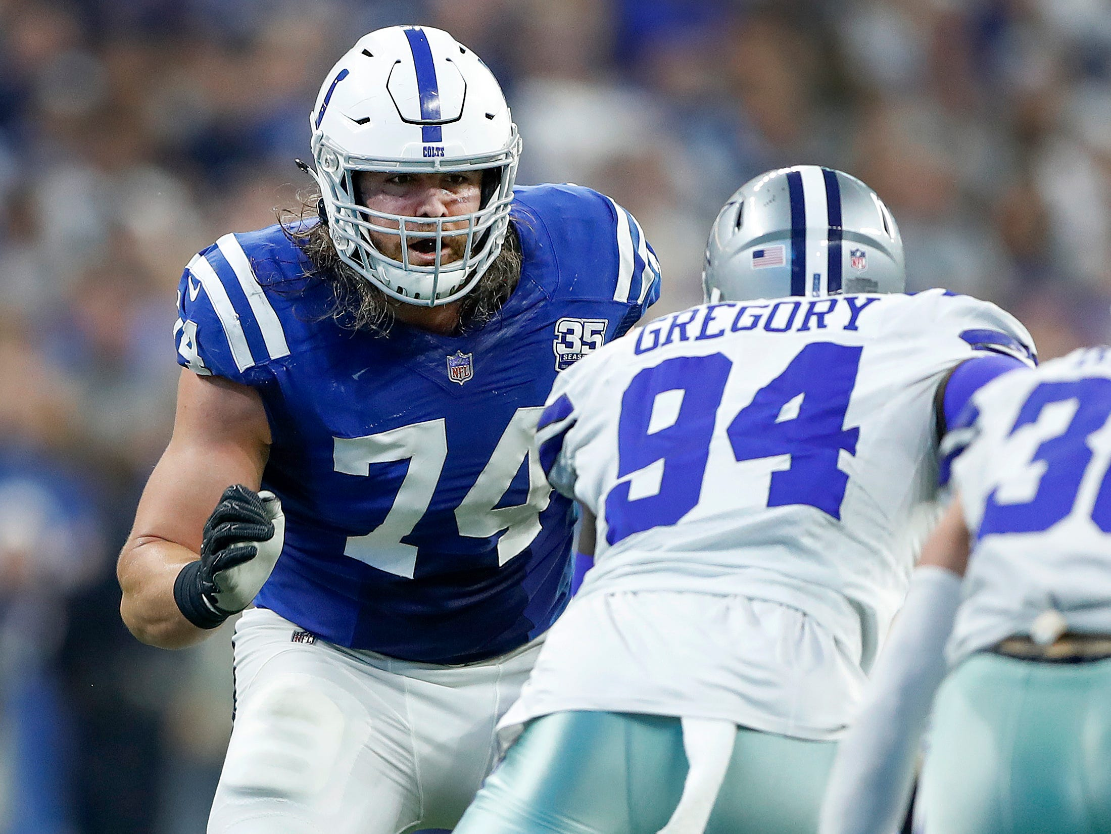 Indianapolis Colts offensive tackle Anthony Castonzo (74) prepares to block Dallas Cowboys defensive end Randy Gregory (94) in the second half of their game at Lucas Oil Stadium on Sunday, Dec. 16, 2018. The Colts shut-out the Cowboys 23-0.