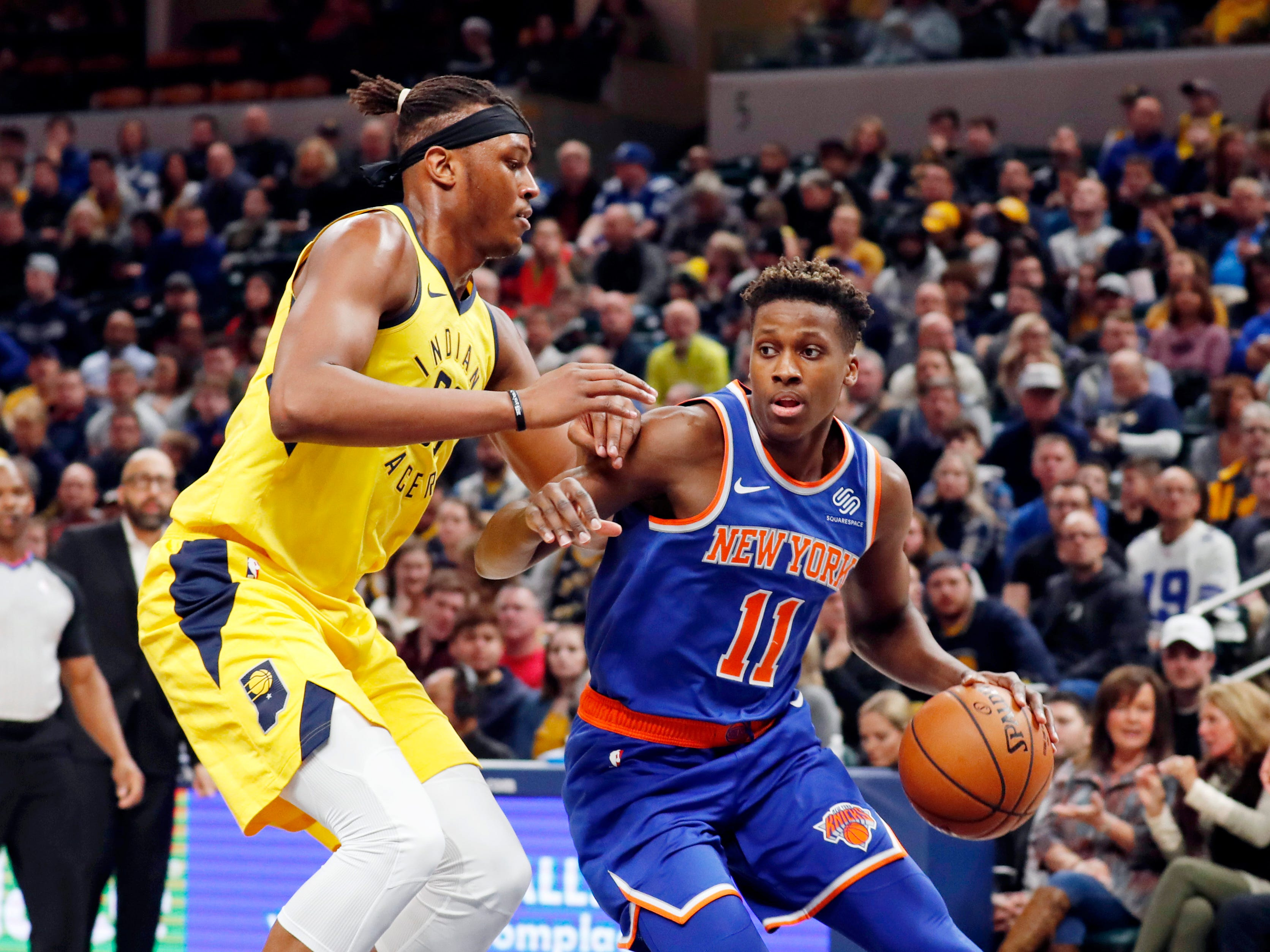 Dec 16, 2018; Indianapolis, IN, USA; New York Knicks guard Frank Ntilikina (11) drives to the basket against Indiana Pacers center Myles Turner (33) during the first quarter at Bankers Life Fieldhouse.