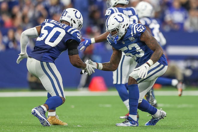 Indianapolis Colts middle linebacker Anthony Walker (50) and Indianapolis Colts outside linebacker Darius Leonard (53) celebrate an offensive play in the second half of the game at Lucas Oil Stadium in Indianapolis, Sunday, Dec. 16, 2018. The Colts won, 23-0.