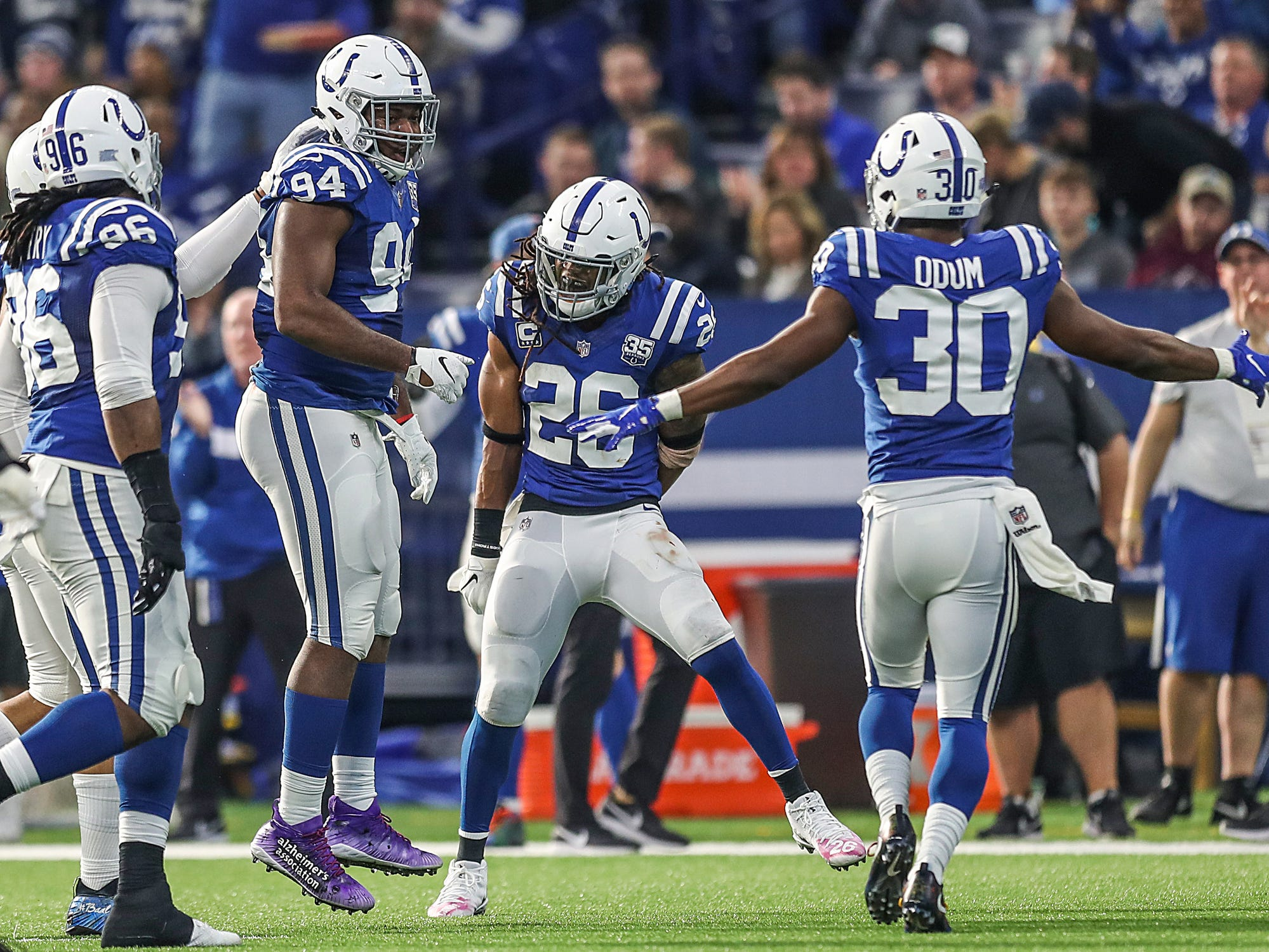 Indianapolis Colts defensive end Tyquan Lewis (94) celebrates his second quarterback sack of the game, in the first half at Lucas Oil Stadium in Indianapolis, Sunday, Dec. 16, 2018.