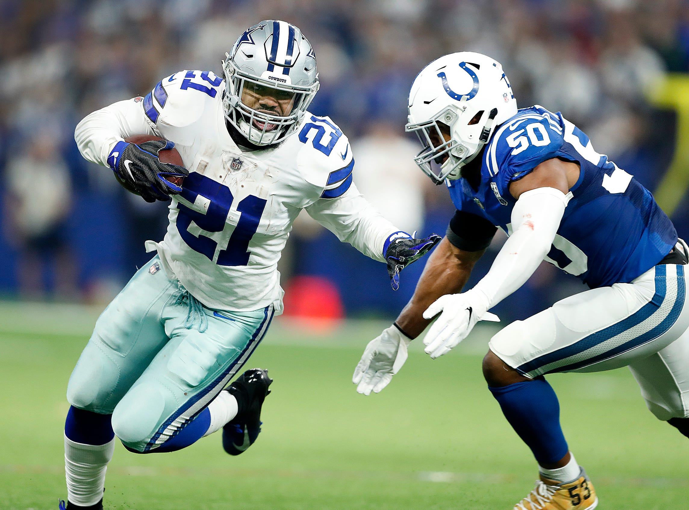 Indianapolis Colts middle linebacker Anthony Walker (50) closes in for the tackle on Dallas Cowboys running back Ezekiel Elliott (21)  in the first half of their game at Lucas Oil Stadium on Sunday, Dec. 16, 2018.