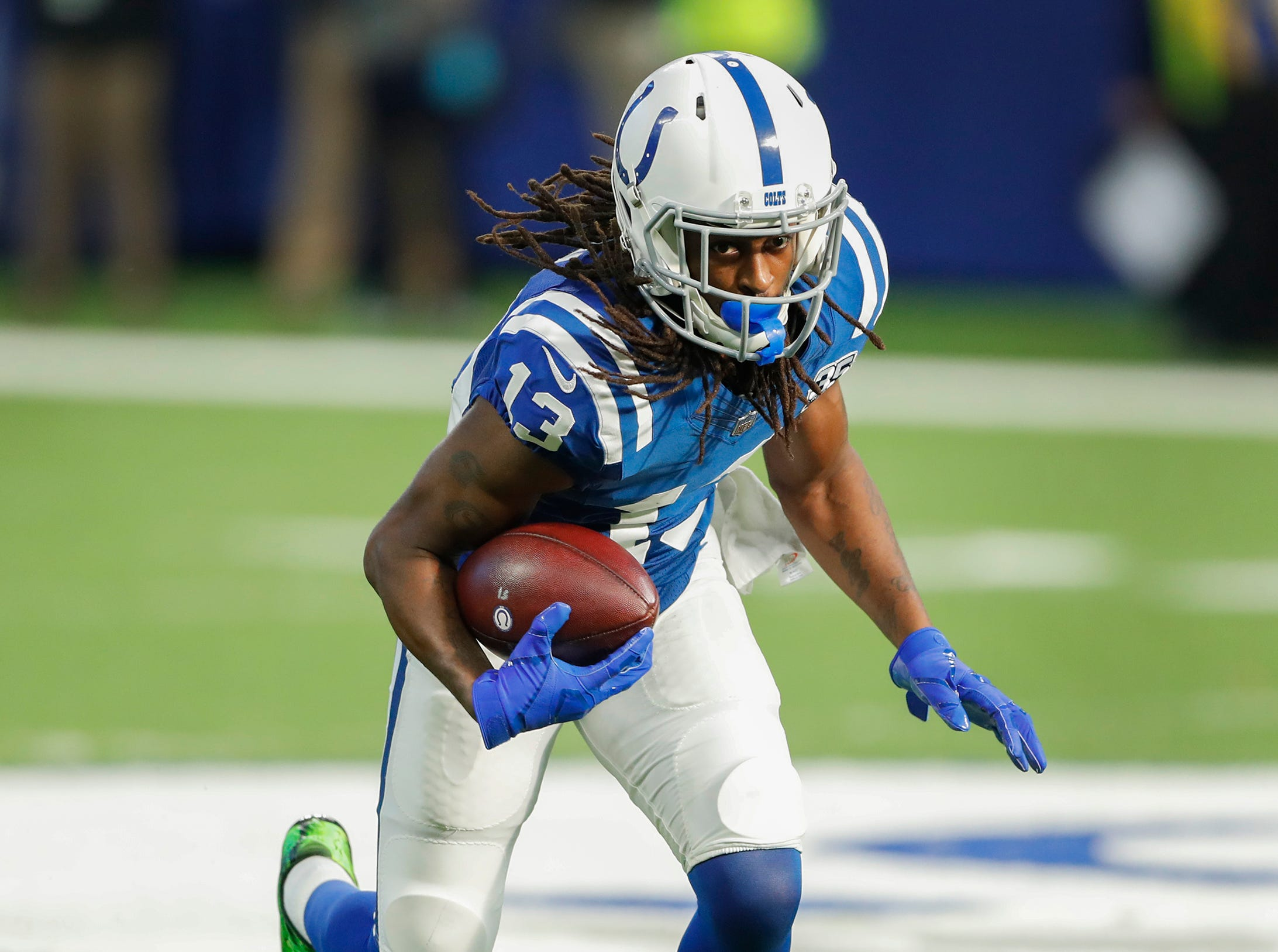 Indianapolis Colts wide receiver T.Y. Hilton (13) turns upfield after a catch in the first half of their game at Lucas Oil Stadium on Sunday, Dec. 16, 2018.