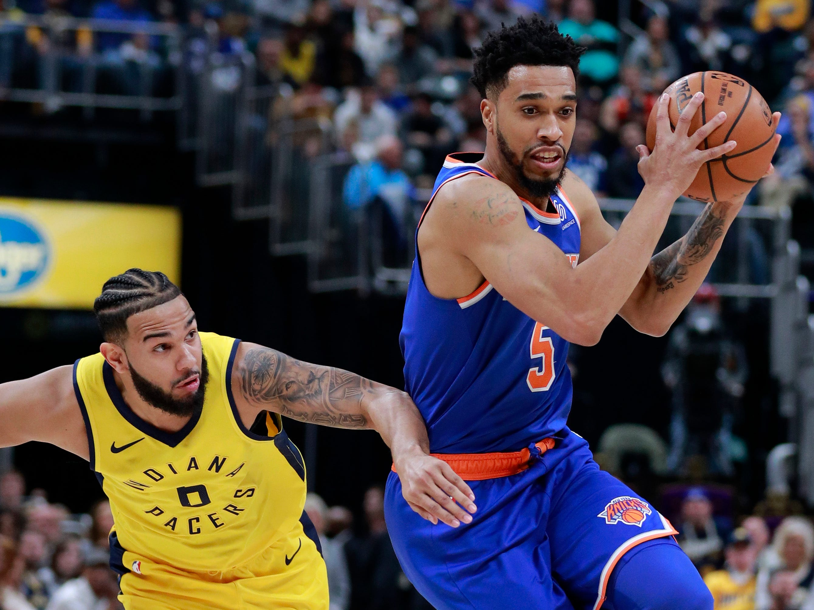 New York Knicks guard Courtney Lee, right controls the basketball defended by Indiana Pacers guard Cory Joseph during the first half of an NBA basketball game, Sunday, Dec. 16, 2018, in Indianapolis. (AP Photo/R Brent Smith)