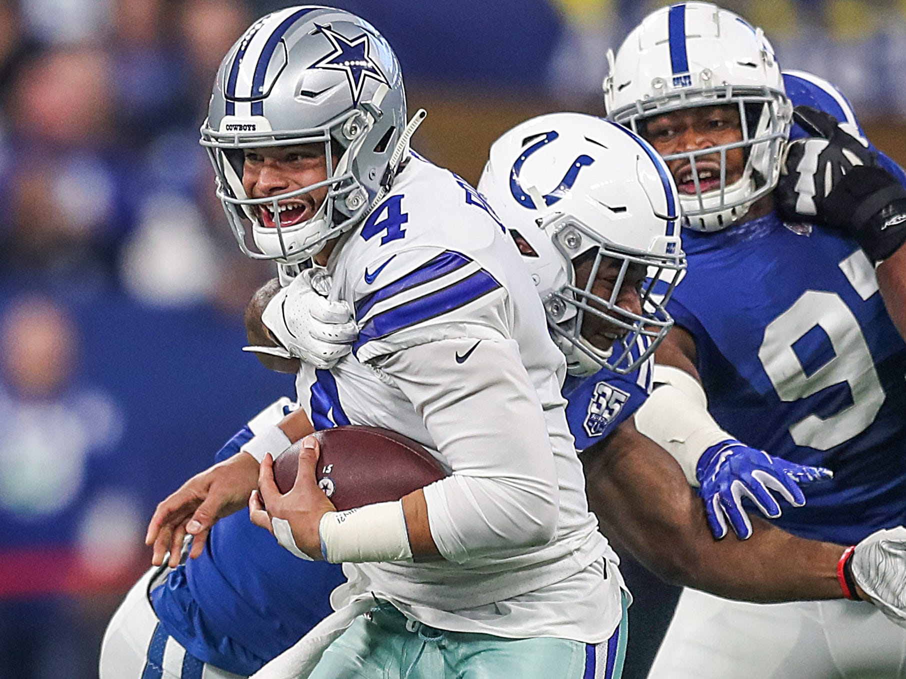 Indianapolis Colts defensive end Tyquan Lewis (94) sacks Dallas Cowboys quarterback Dak Prescott (4) in the first half of the game at Lucas Oil Stadium in Indianapolis, Sunday, Dec. 16, 2018.
