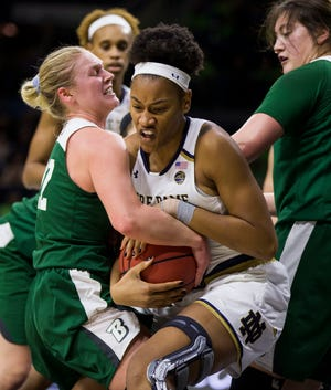 Binghamton's Lizzy Spindler, left, competes for the ball with Notre Dame's Mikayla Vaughn during the first half of an NCAA college basketball game Sunday, Dec. 16, 2018, in South Bend, Ind.