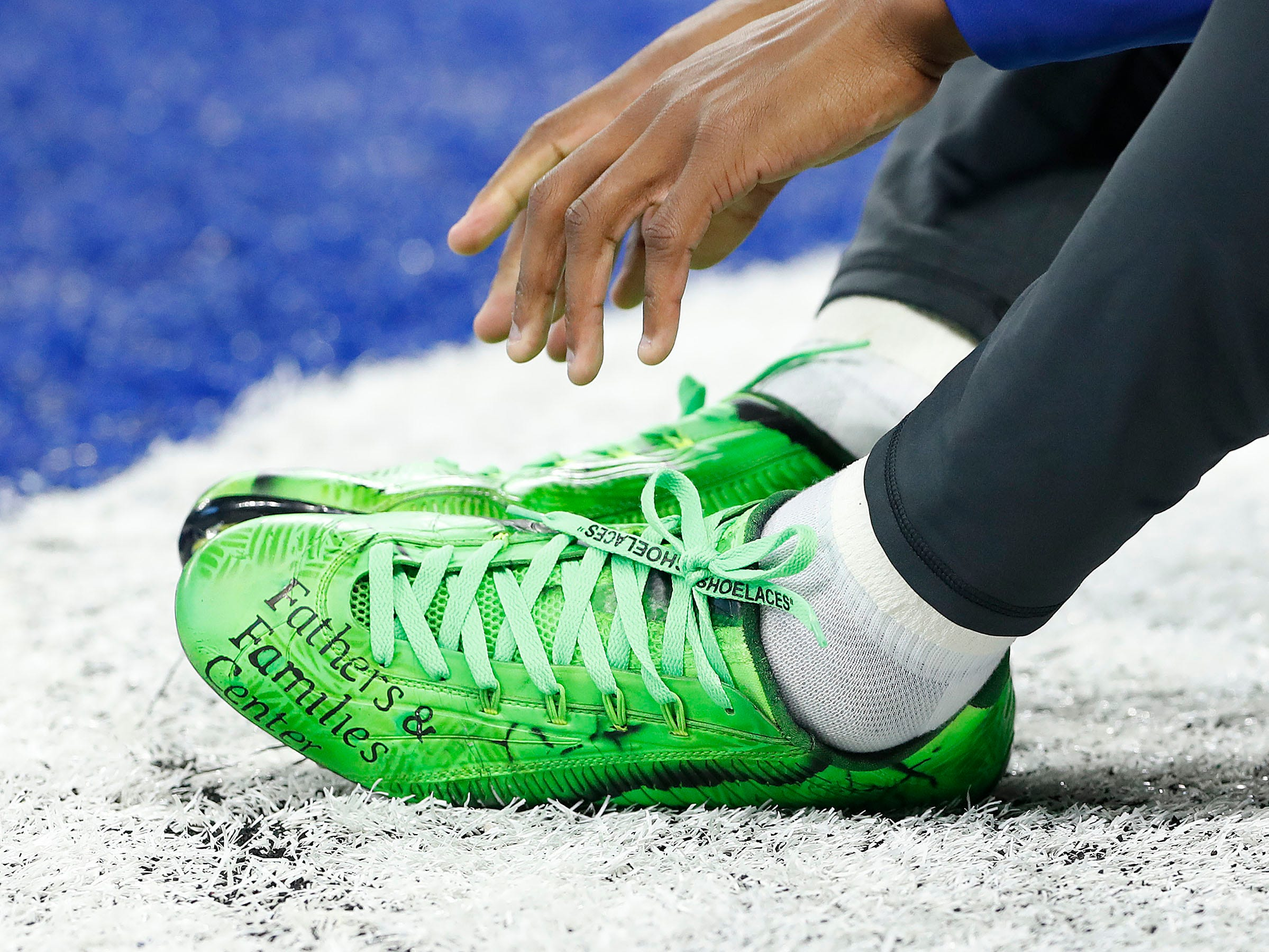 Indianapolis Colts wide receiver T.Y. Hilton (13) and his My Cleats, My Cause before the start of their game against the Dallas Cowboys at Lucas Oil Stadium on Sunday, Dec. 16, 2018.