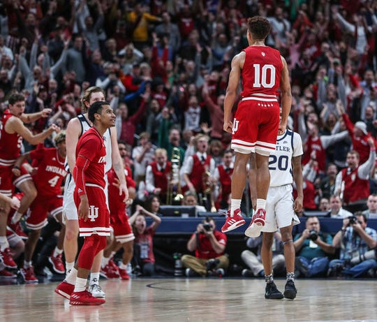 Indiana Hoosiers guard Rob Phinisee (10) jumps into the air after scoring the game-winning three-pointer at the buzzer, in the Crossroads Classic game against Butler at Banker's Life Fieldhouse in Indianapolis, Saturday, Dec. 15, 2018. The Hoosiers won, 71-68.