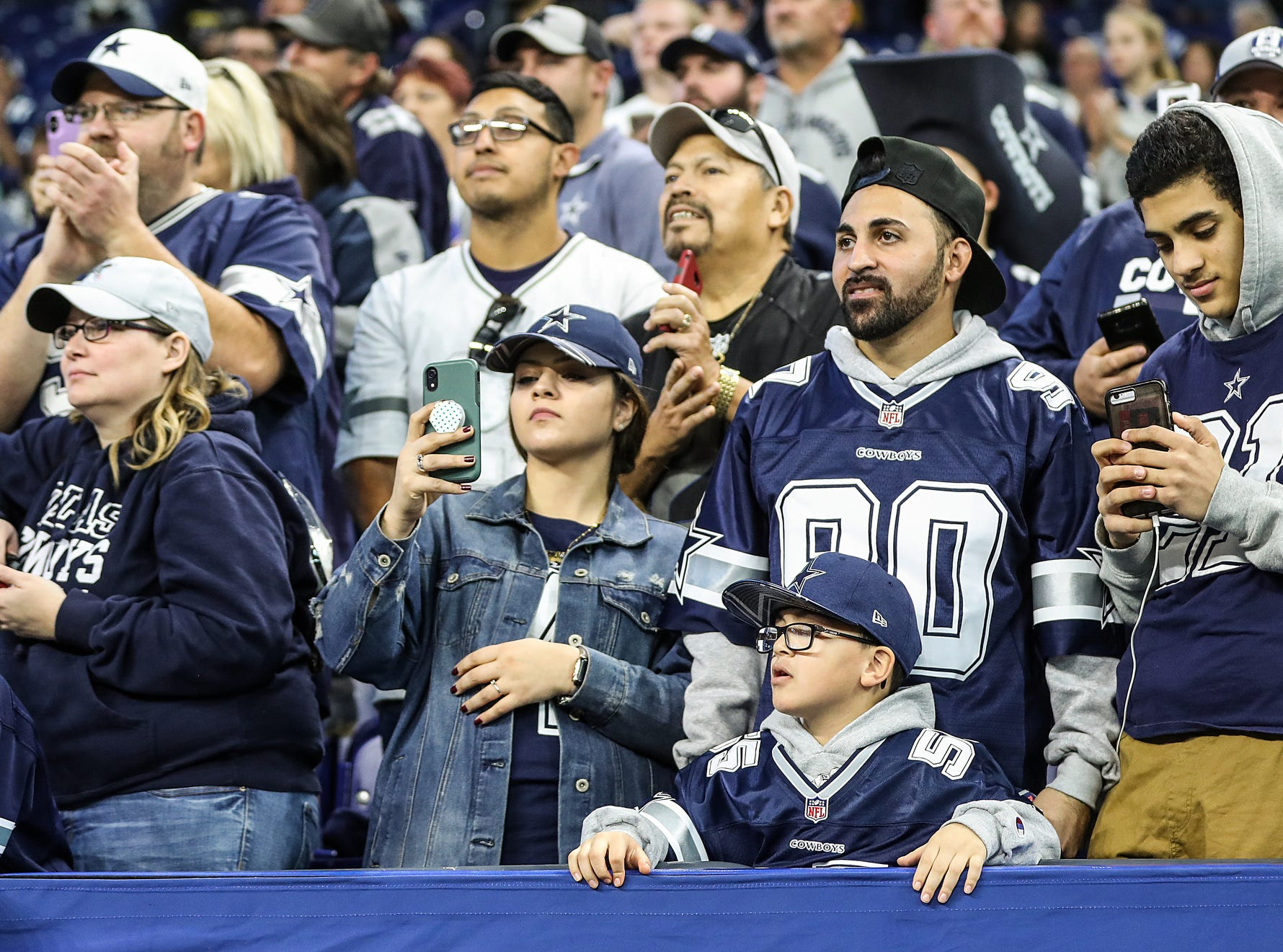 Dallas Cowboys fans hope for an autograph from team owner Jerry Jones before the team faced the Indianapolis Colts in week 15 at Lucas Oil Stadium in Indianapolis, Sunday, Dec. 16, 2018.