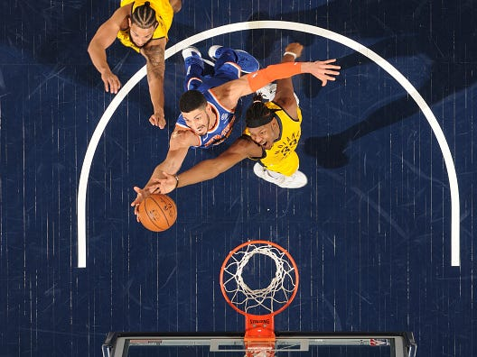 INDIANAPOLIS, IN - DECEMBER 16: Enes Kanter #00 of the New York Knicks and Myles Turner #33 of the Indiana Pacers fight for the rebound on December 16, 2018 at Bankers Life Fieldhouse in Indianapolis, Indiana.