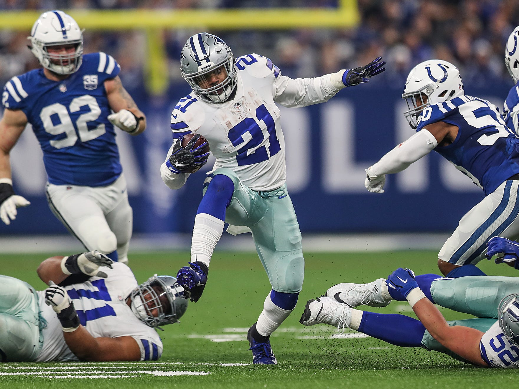 Indianapolis Colts running back Nyheim Hines (21) weaves through Dallas defenders in the first half of the game at Lucas Oil Stadium in Indianapolis, Sunday, Dec. 16, 2018.