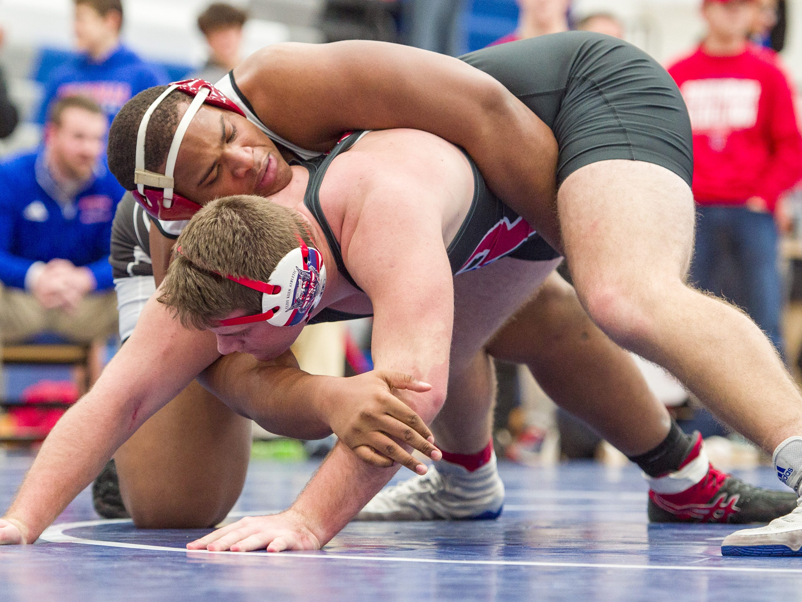 North Central High School wrestler Jamichael Watts, top, wrestles with Roncalli High School's John Harris in the 285-pound weight class. Franklin Central High School hosted the Marion County wrestling championships, Saturday, Dec. 15, 2018.