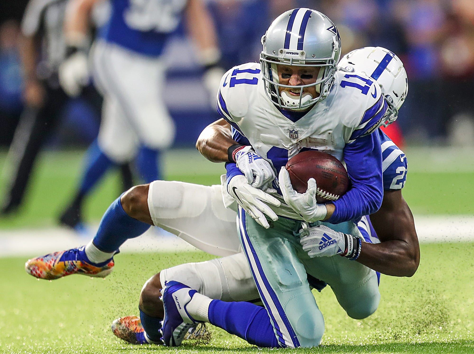 Indianapolis Colts cornerback Kenny Moore (23) tackles Dallas Cowboys wide receiver Cole Beasley (11) in the second half of the game at Lucas Oil Stadium in Indianapolis, Sunday, Dec. 16, 2018. The Colts won, 23-0.