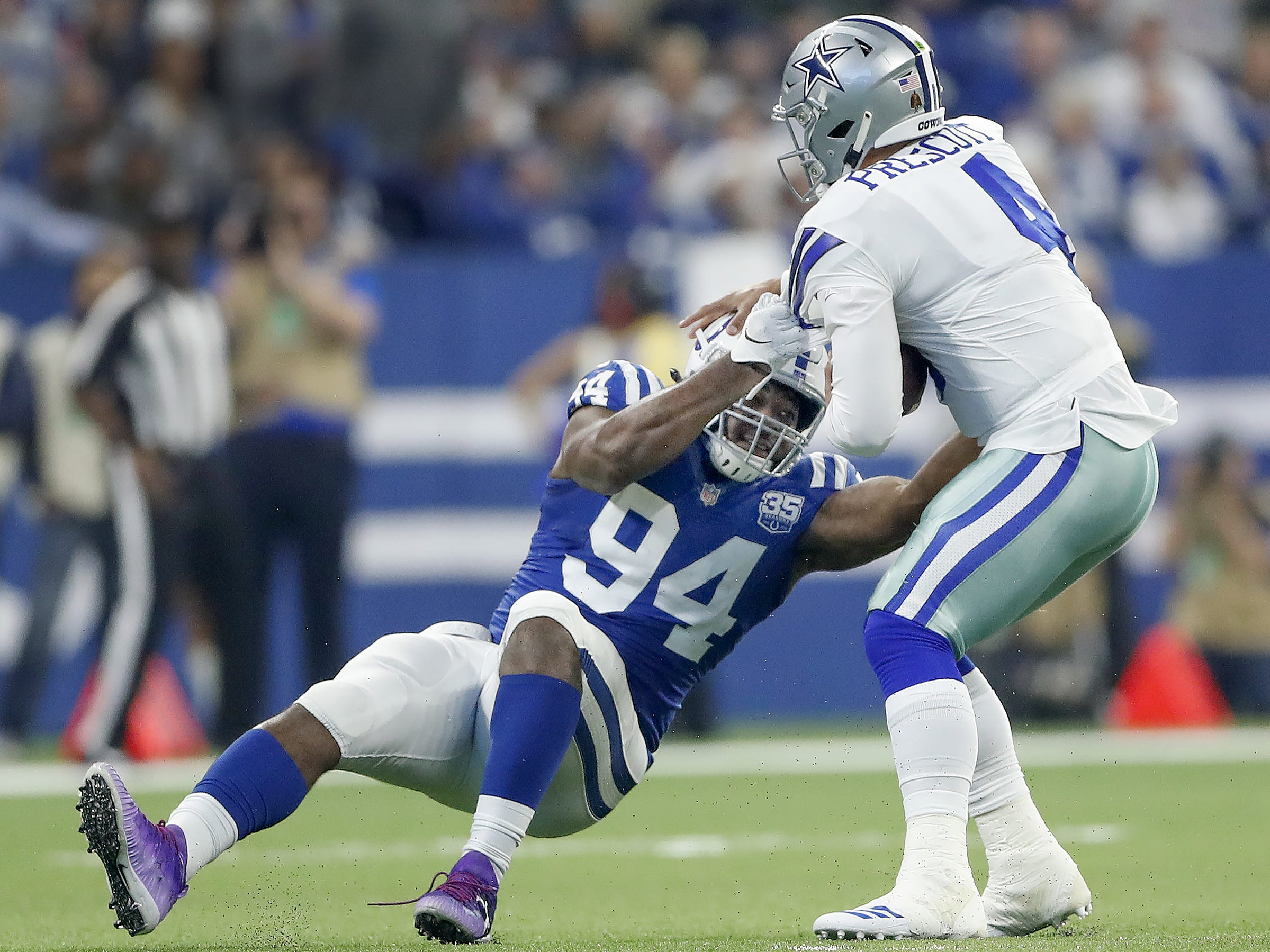 Indianapolis Colts defensive end Tyquan Lewis (94) sacks Dallas Cowboys quarterback Dak Prescott (4) in the first half of their game at Lucas Oil Stadium on Sunday, Dec. 16, 2018.