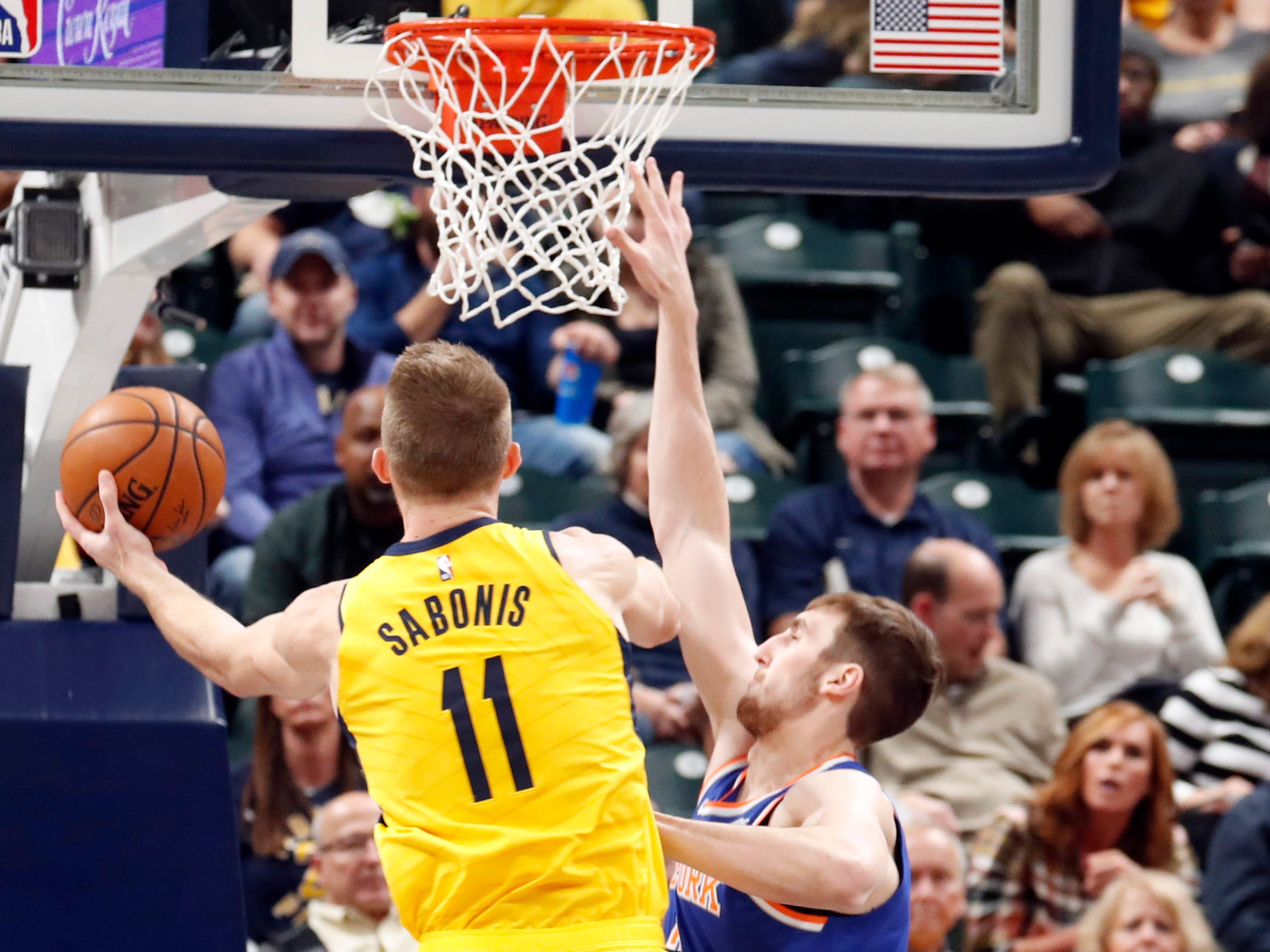 Dec 16, 2018; Indianapolis, IN, USA; Indiana Pacers forward Domantas Sabonis (11) goes up for a shot against New York Knicks center Luke Kornet (2) during the first quarter at Bankers Life Fieldhouse.