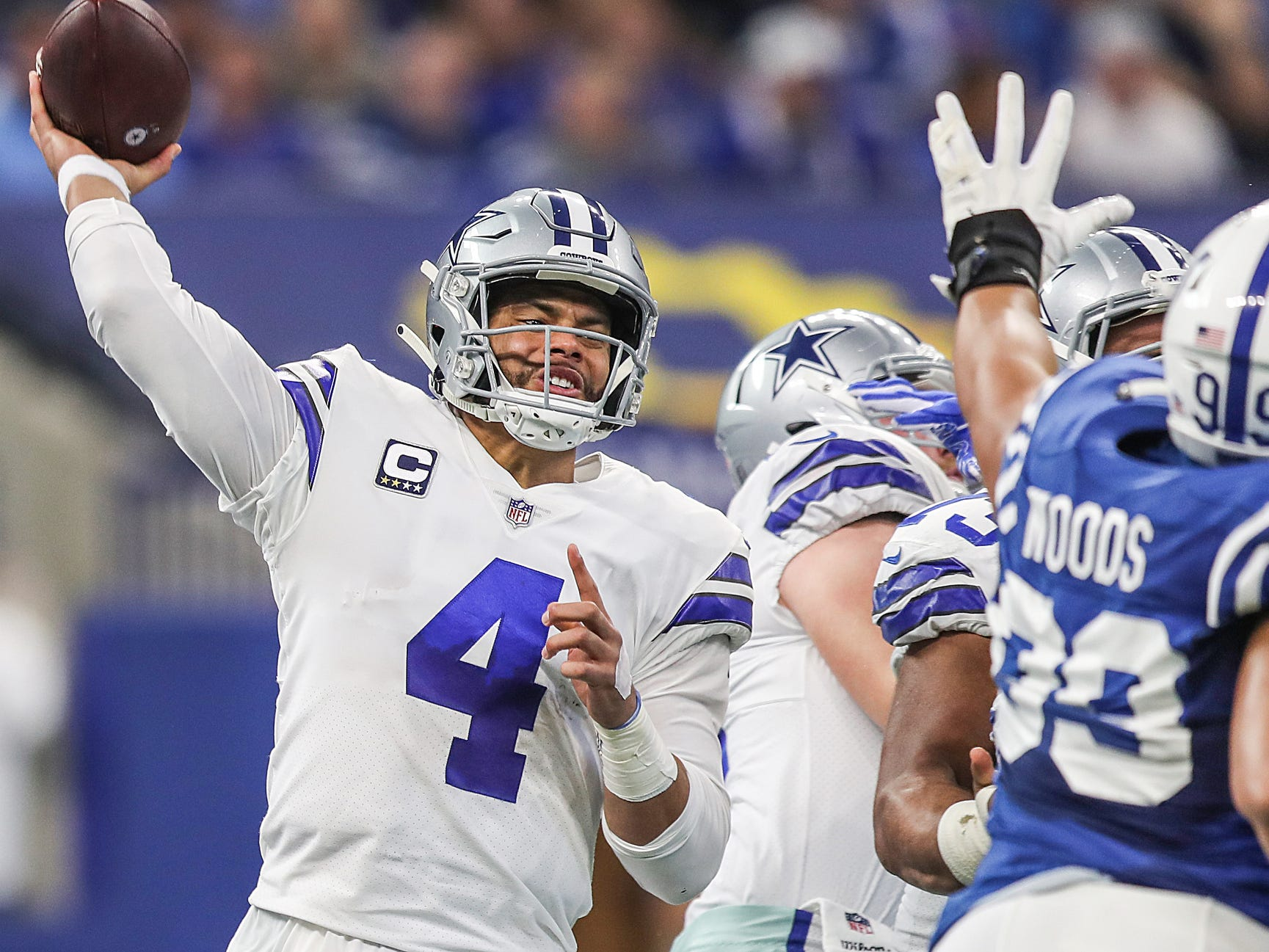 Dallas Cowboys quarterback Dak Prescott (4) is pressured by Colts defenders in the first half of the game at Lucas Oil Stadium in Indianapolis, Sunday, Dec. 16, 2018.