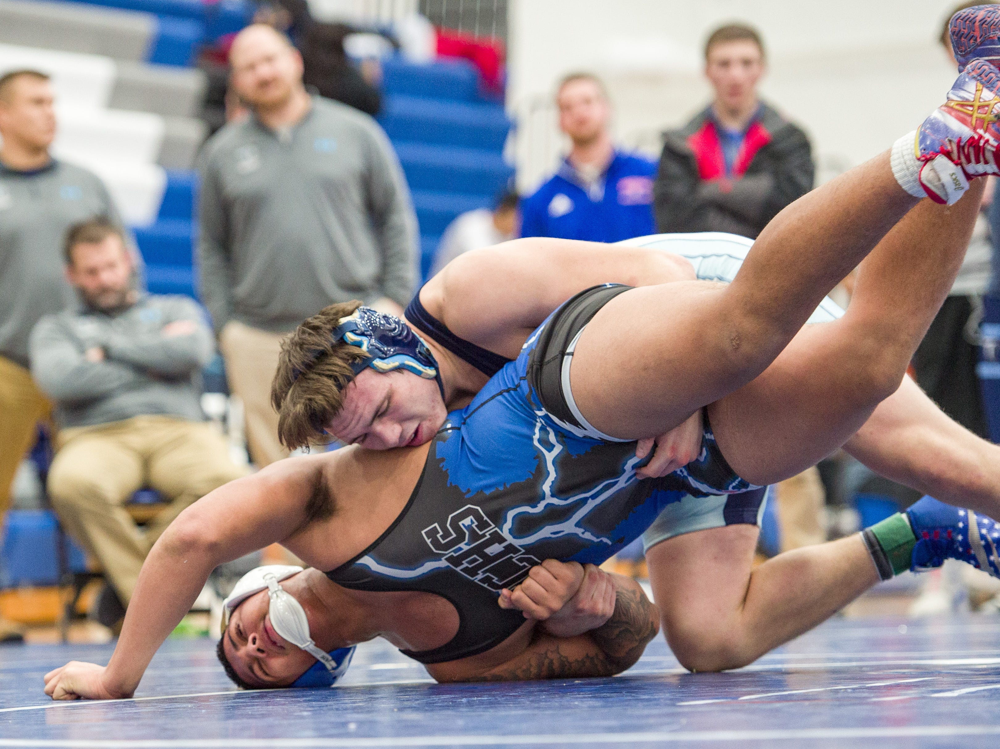 Perry Meridian High School wrestler Austin Lane, right, competes with Franklin Central High School's Deshawn Young in the 220-pound weight class. Franklin Central High School hosted the Marion County wrestling championships, Saturday, Dec. 15, 2018.