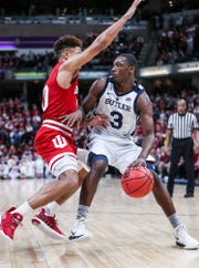 Indiana Hoosiers guard Rob Phinisee (10) guards Butler Bulldogs guard Kamar Baldwin (3) in the second half of the Crossroads Classic game at Banker's Life Fieldhouse in Indianapolis, Saturday, Dec. 15, 2018. The Hoosiers won, 71-68.