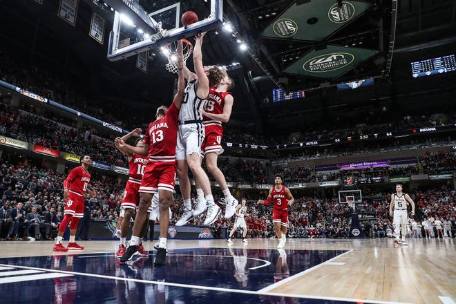 Indiana Hoosiers and Butler Bulldogs go up for a rebound during the Crossroads Classic game against Butler at Banker's Life Fieldhouse in Indianapolis, Saturday, Dec. 15, 2018. The Hoosiers won, 71-68.