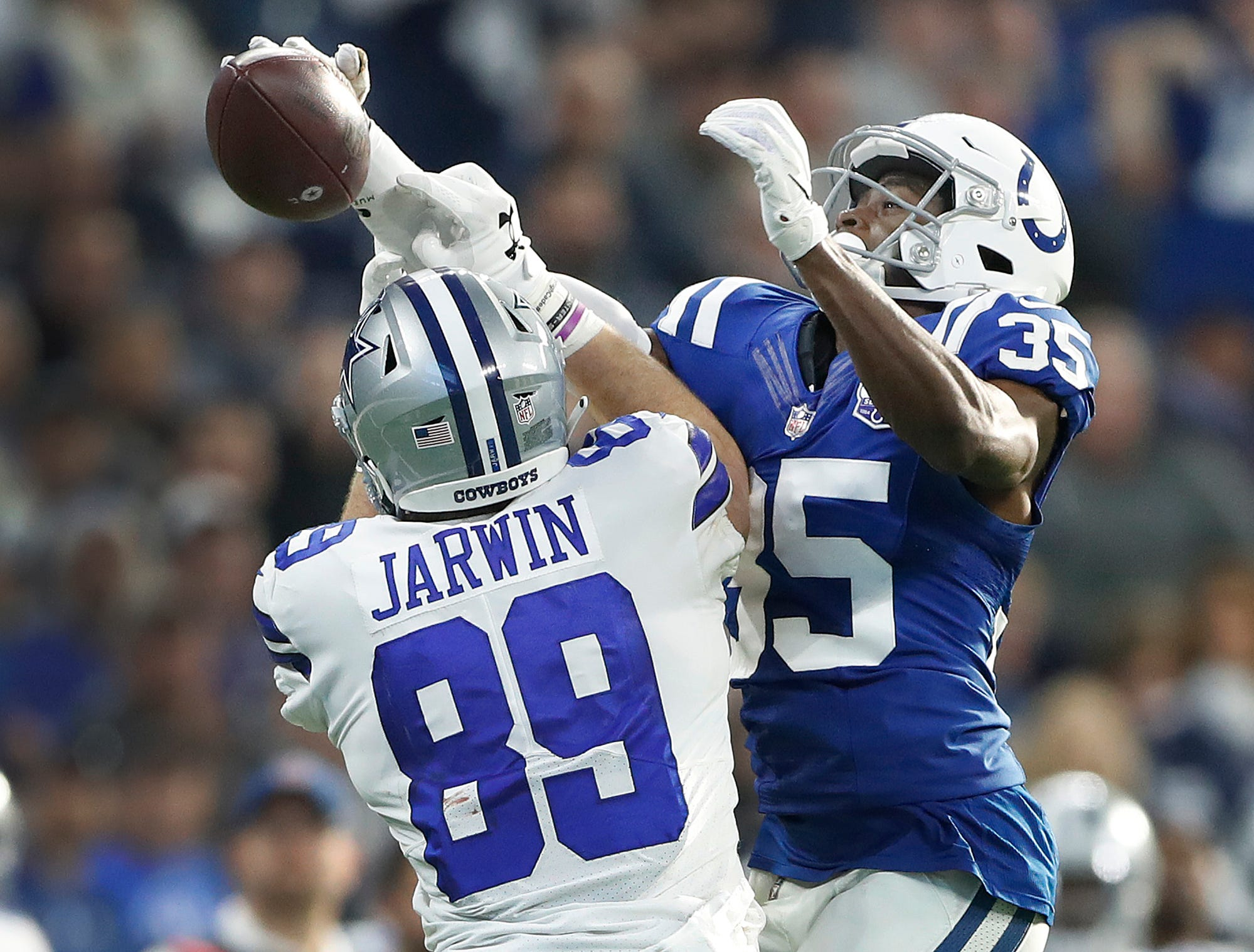 Indianapolis Colts cornerback Pierre Desir (35) breaks up a pass intended for Dallas Cowboys tight end Blake Jarwin (89) in the second half of their game at Lucas Oil Stadium on Sunday, Dec. 16, 2018. The Colts shut-out the Cowboys 23-0.