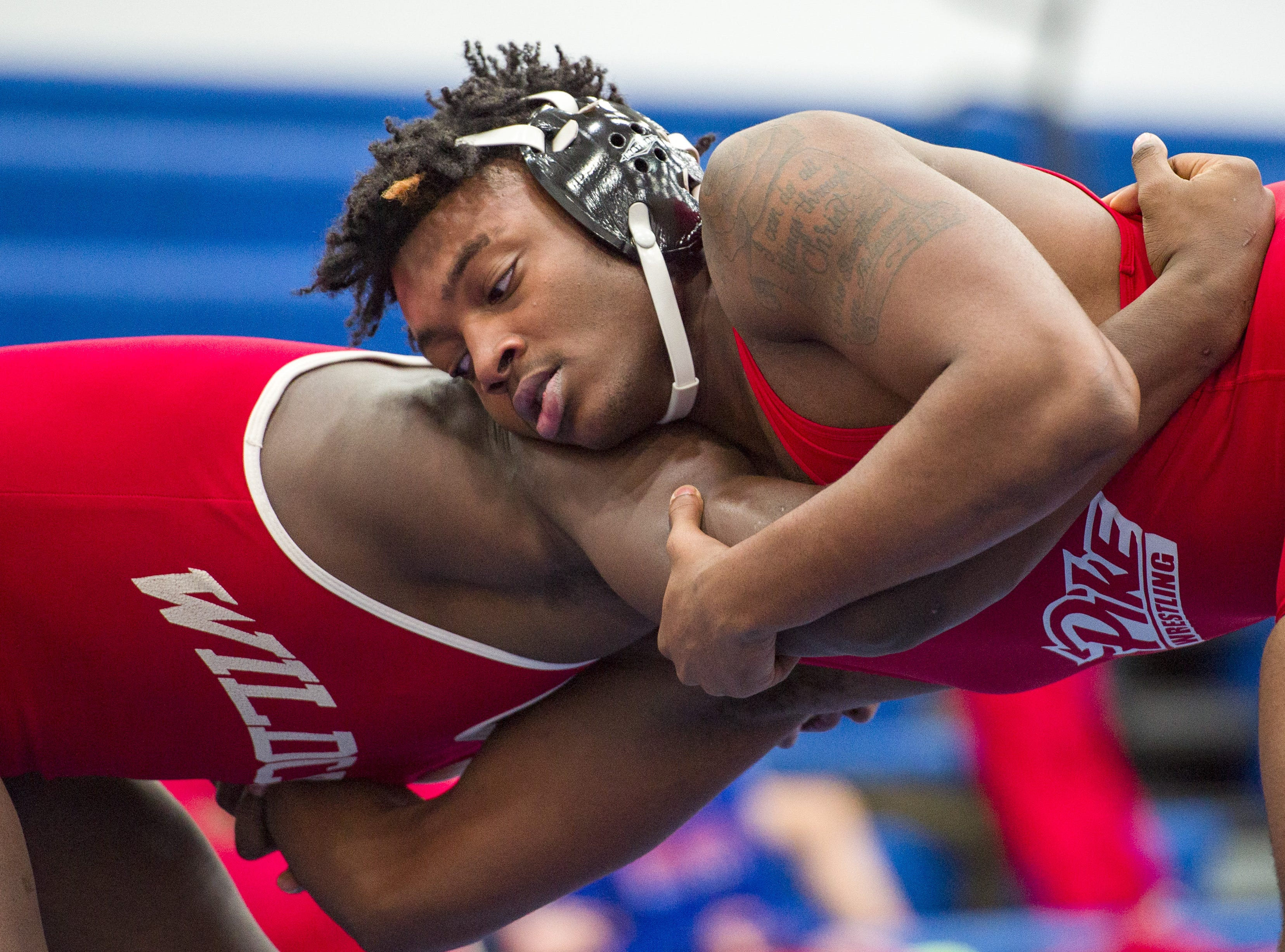 Pike High School wrestler Dakari Kenny, right wrestles with Lawrence North High School's Deon Pettiford in the 195-pound weight class. Franklin Central High School hosted the Marion County wrestling championships, Saturday, Dec. 15, 2018.