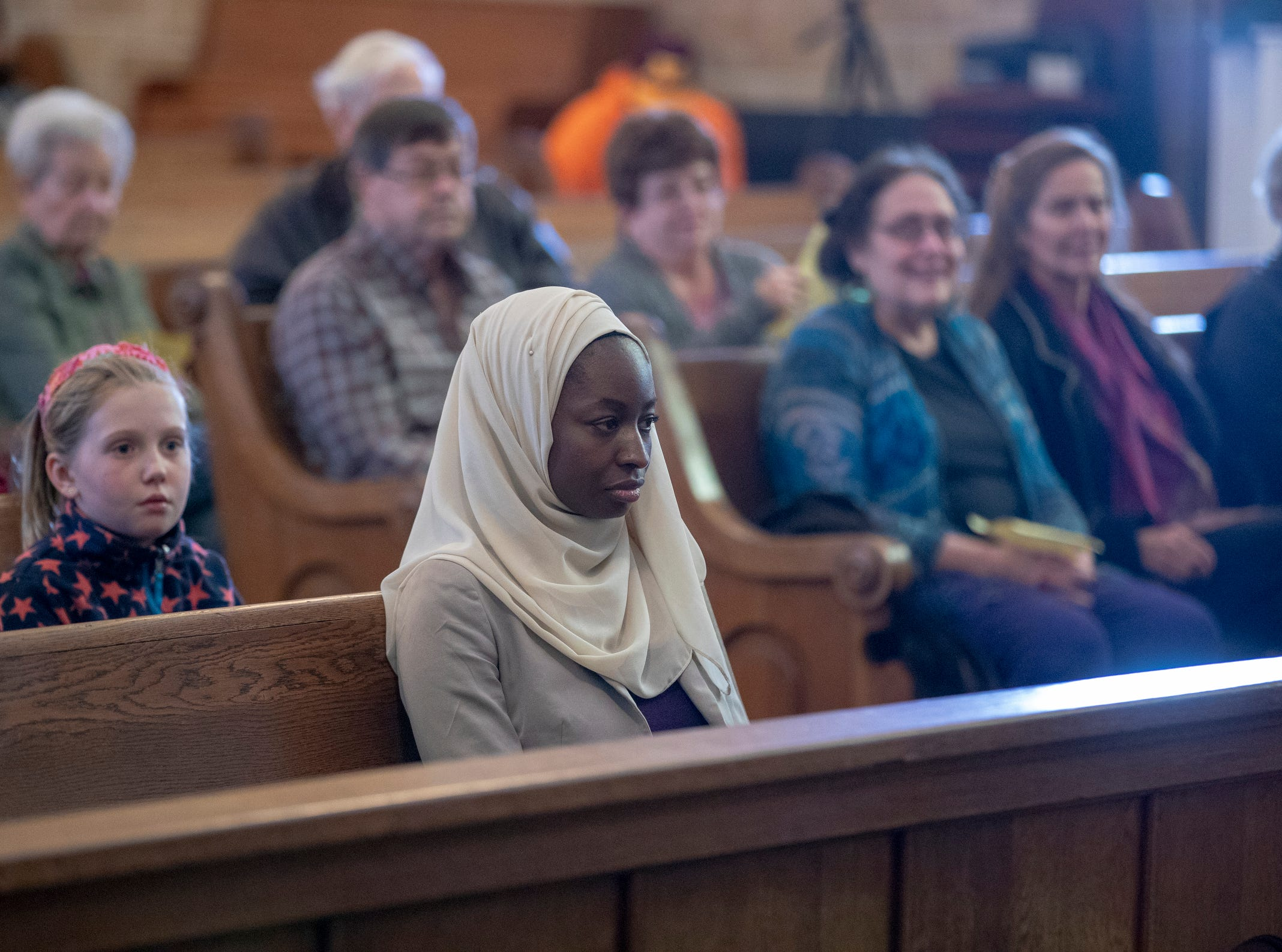 About 40 people, including Halima Al-Khattab (front), attend a Christian-Muslim prayer service at Saint Philip Neri Catholic Church, Indianapolis, Sunday, Dec. 16, 2018. The service is the second annual, and joins people from this church and Indianapolis' Masjid Al-Fajr.