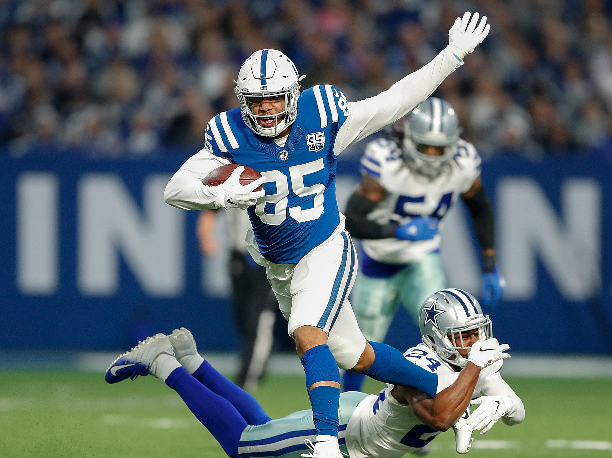 Indianapolis Colts tight end Eric Ebron (85) runs away from Dallas Cowboys cornerback Chidobe Awuzie (24) in the first half of their game at Lucas Oil Stadium on Sunday, Dec. 16, 2018.