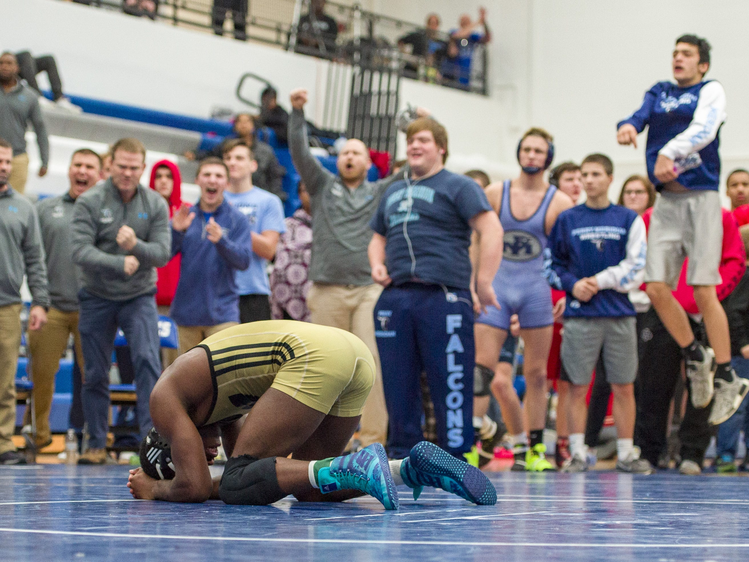 Warren Central High School wrestler Antwaun Graves reacts to his loss to Perry Meridian High School's Aiden Warren in the 145-pound weight class. Franklin Central High School hosted the Marion County wrestling championships, Saturday, Dec. 15, 2018.