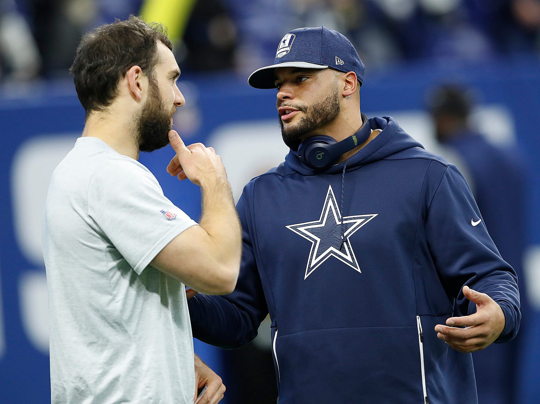 Indianapolis Colts quarterback Andrew Luck (12) talsk with Dallas Cowboys quarterback Dak Prescott (4) before the start of their game against the Dallas Cowboys at Lucas Oil Stadium on Sunday, Dec. 16, 2018.