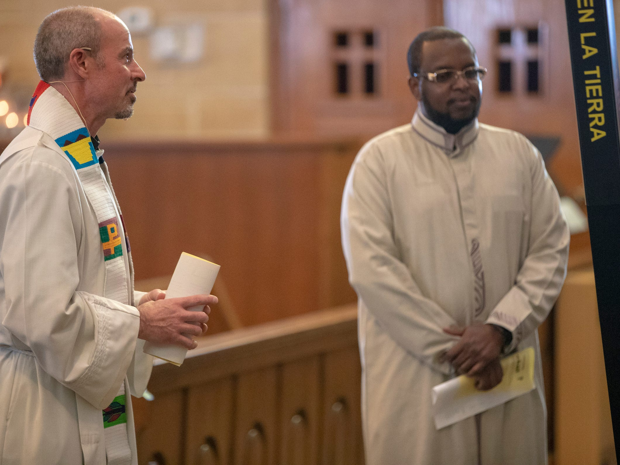 Fr. Chris Wadelton (left), and Imam Ahmed Al-Amine help lead a Christian-Muslim prayer service at Saint Philip Neri Catholic Church, Indianapolis, Sunday, Dec. 16, 2018. The service is the second annual, and joins people from this church and Indianapolis' Masjid Al-Fajr.