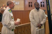 Father Chris Wadelton (left), and Imam Ahmed Alamine help lead a Christian-Muslim prayer service at Saint Philip Neri Catholic Church, Indianapolis, Sunday, Dec. 16, 2018. The service is the second annual, and joins people from this church and Indianapolis' Masjid Al-Fajr.