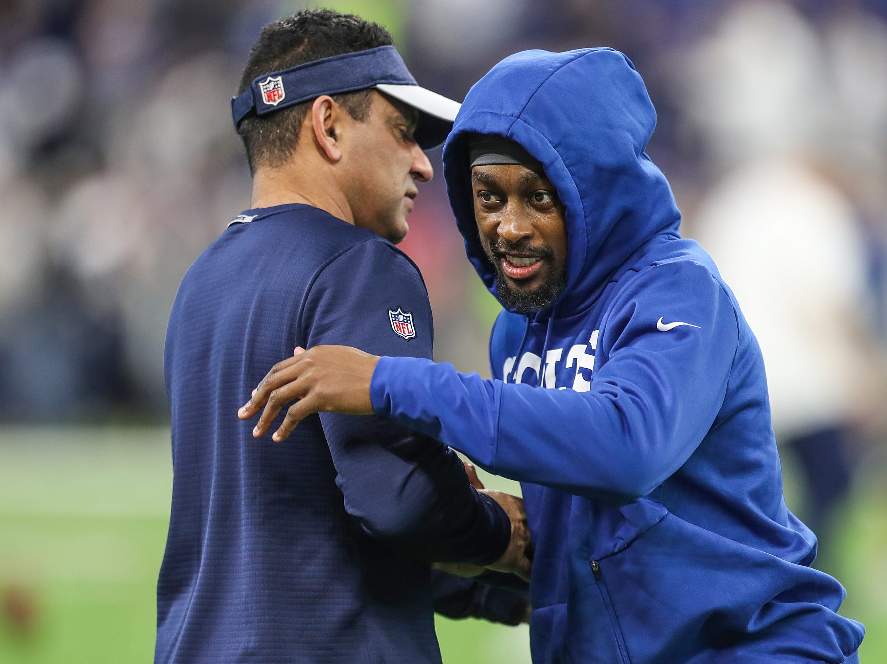Indianapolis Colts wide receiver T.Y. Hilton (13) talks with a Dallas coach before the Colts faced the Dallas Cowboys in week 15 at Lucas Oil Stadium in Indianapolis, Sunday, Dec. 16, 2018.