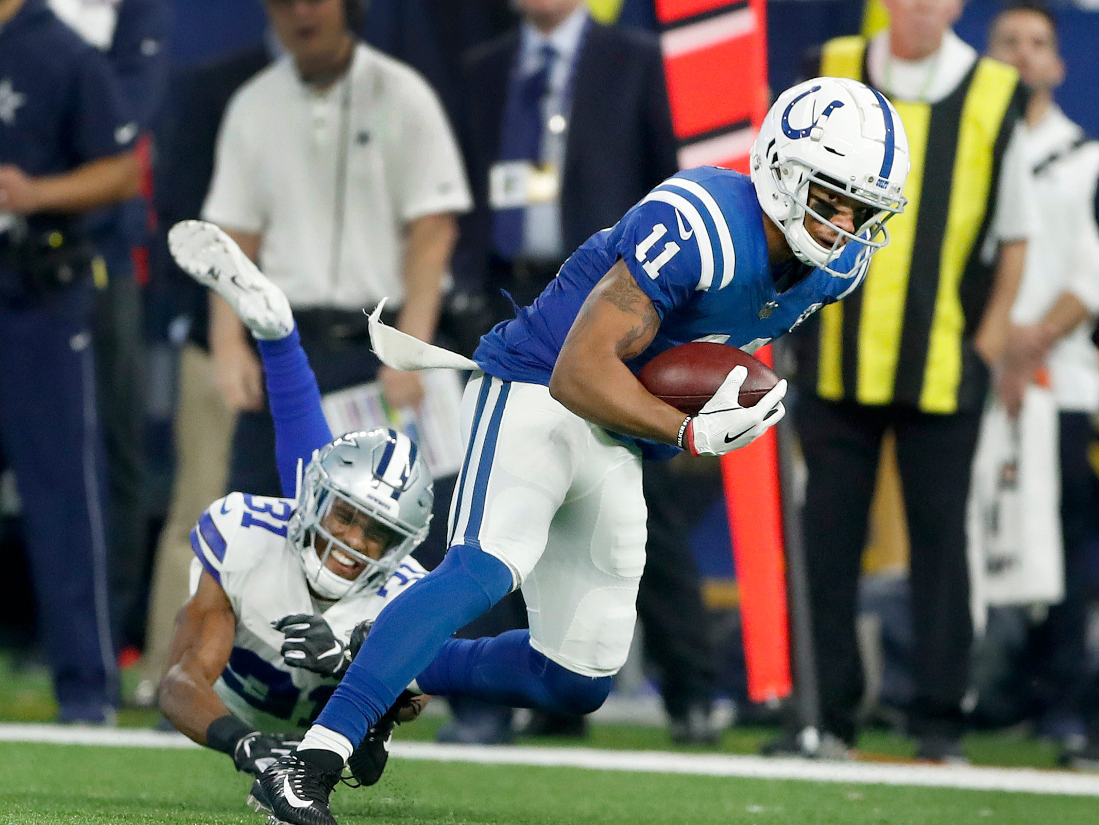 Indianapolis Colts wide receiver Ryan Grant (11) runs away from Dallas Cowboys cornerback Byron Jones (31) in the first half of their game at Lucas Oil Stadium on Sunday, Dec. 16, 2018.