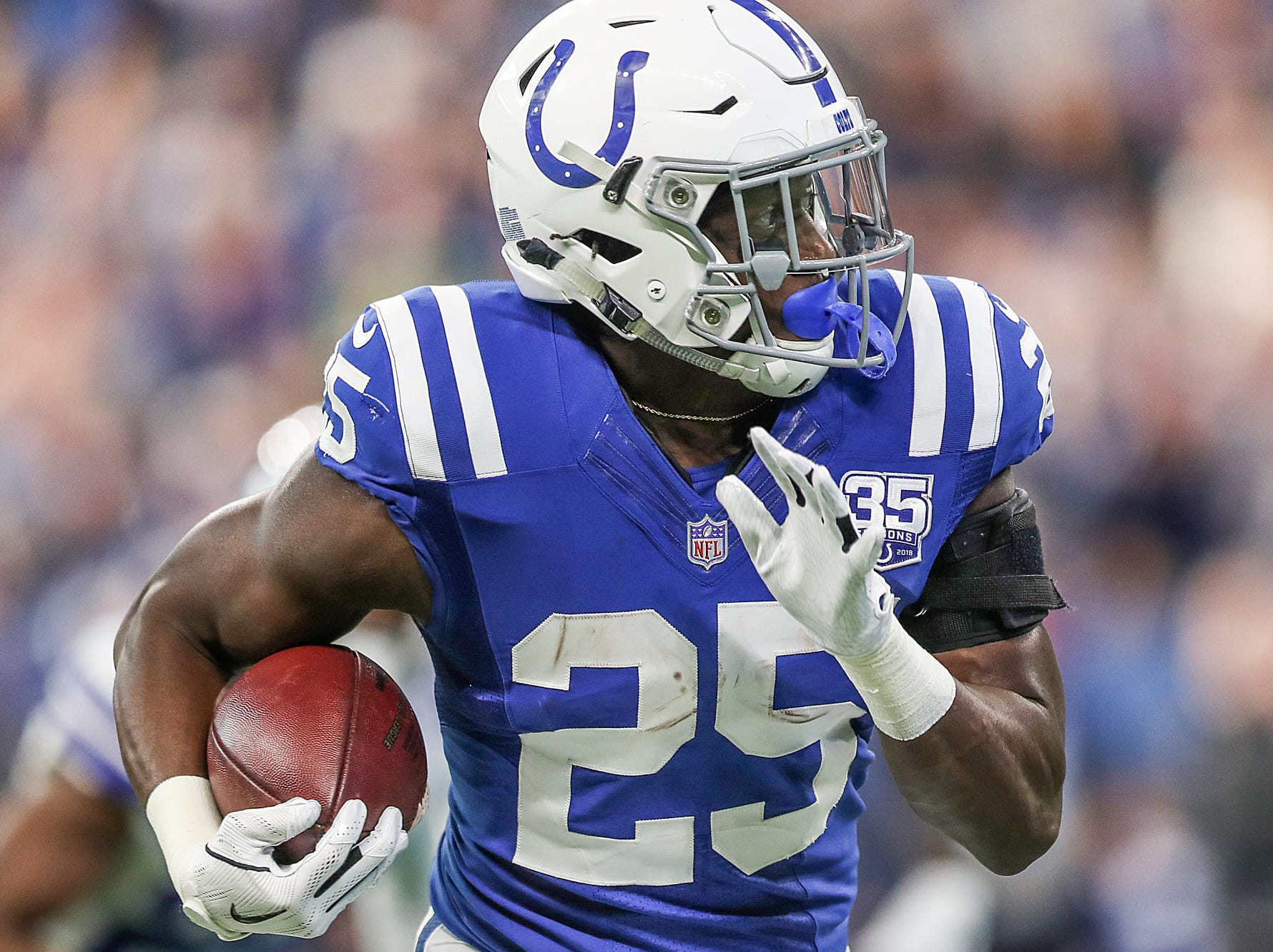 Indianapolis Colts running back Marlon Mack (25) runs the ball in the first half of the game at Lucas Oil Stadium in Indianapolis, Sunday, Dec. 16, 2018. The Colts won, 23-0.