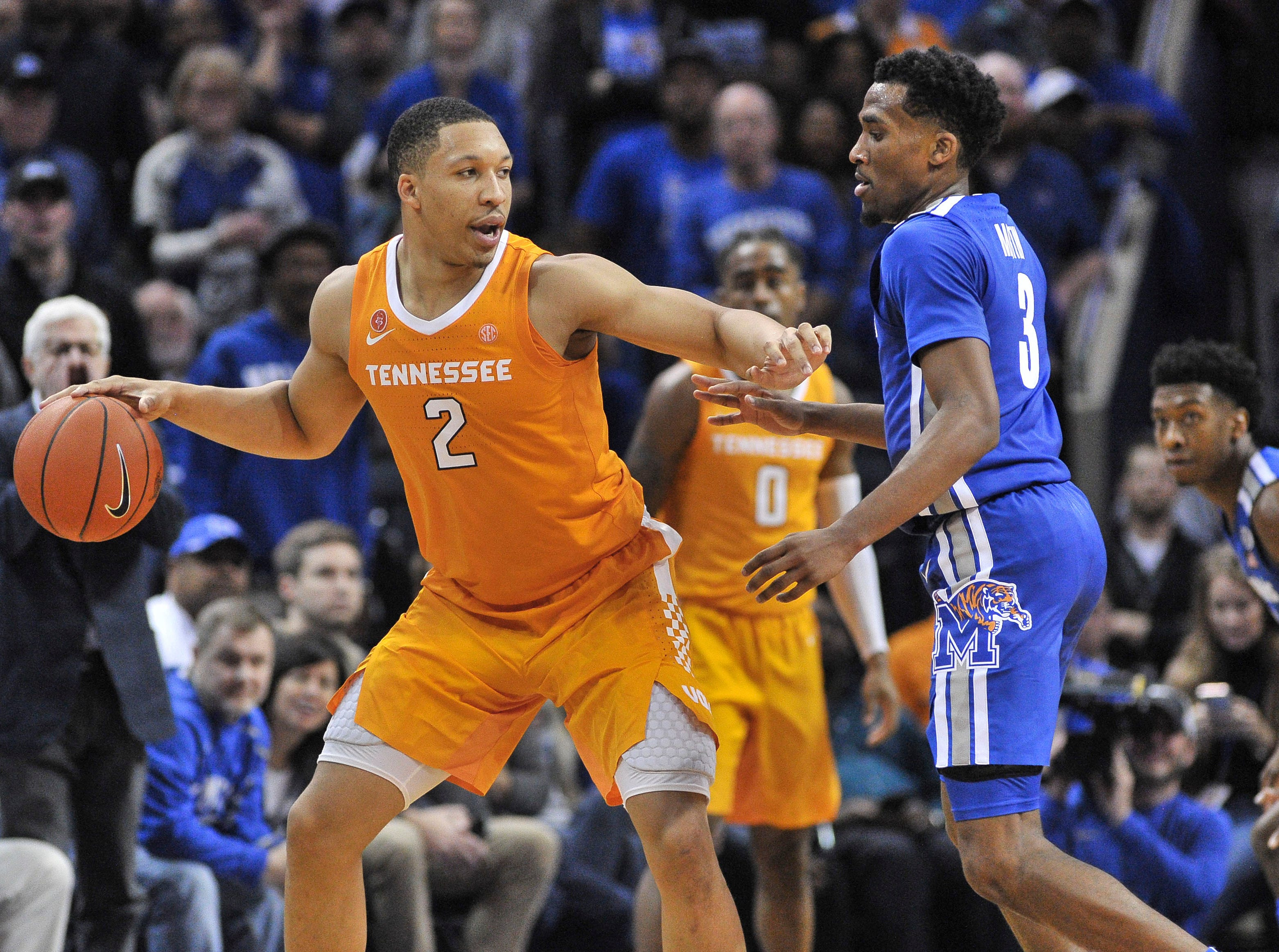 Dec 15, 2018; Memphis, TN, USA; Tennessee Volunteers forward Grant Williams (2) dribbles the ball as Memphis Tigers guard Jeremiah Martin (3) defends during the second half at FedExForum. Mandatory Credit: Justin Ford-USA TODAY Sports