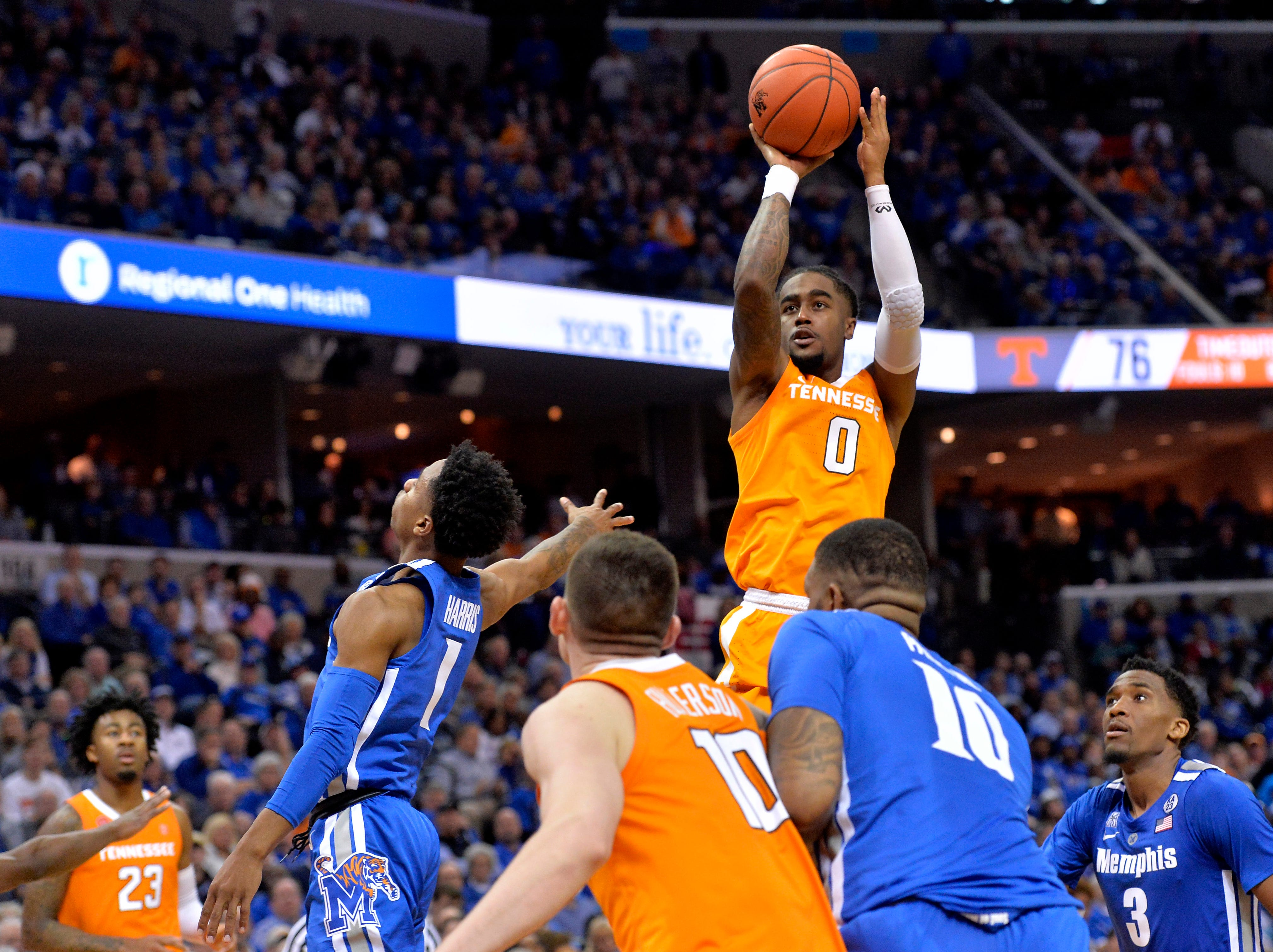 Tennessee guard Jordan Bone (0) shoots between Memphis guards Tyler Harris (1) and Jeremiah Martin (3) in the second half of an NCAA college basketball game Saturday, Dec. 15, 2018, in Memphis, Tenn.
