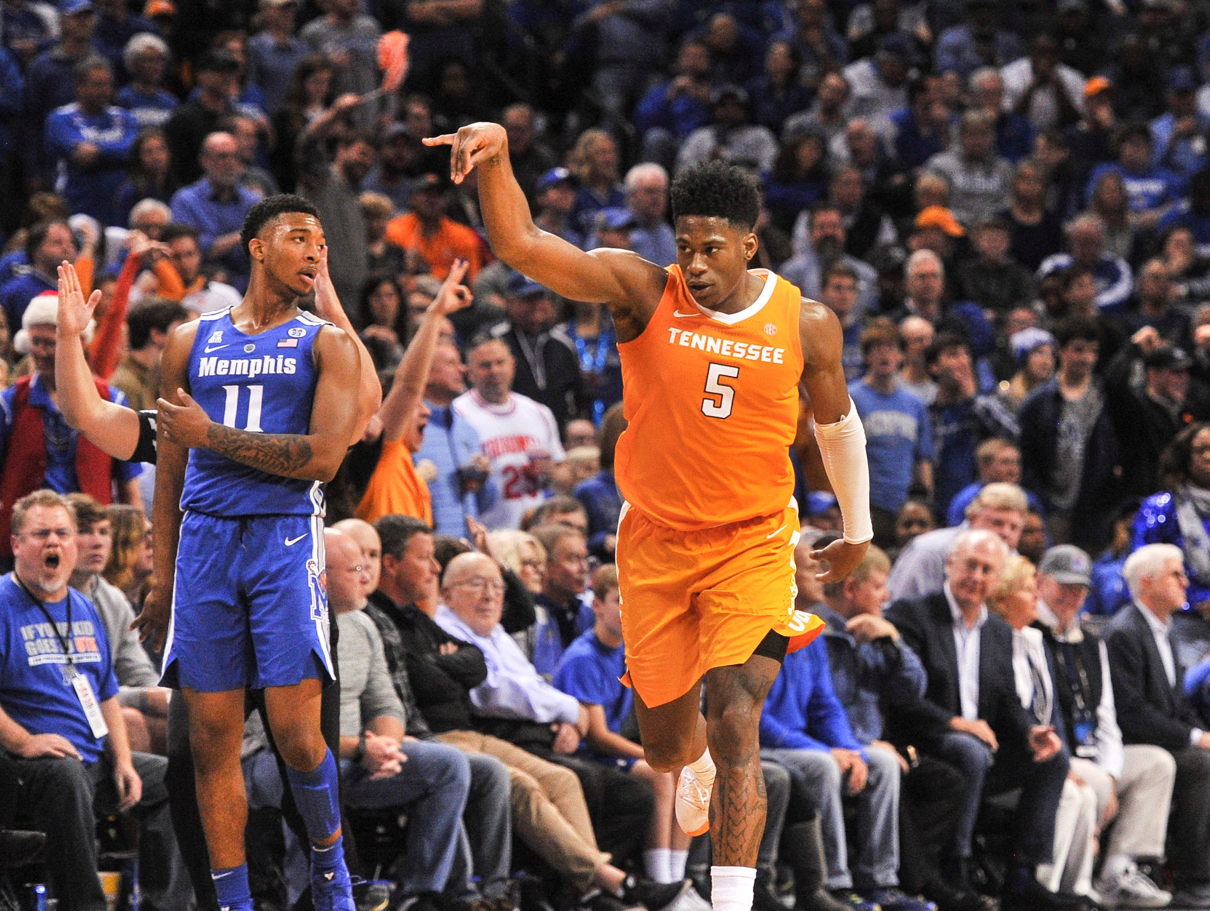 Dec 15, 2018; Memphis, TN, USA; Tennessee Volunteers guard Admiral Schofield (5) reacts after scoring during the second half against Memphis Tigers guard Antwann Jones (11) during the second half at FedExForum. Mandatory Credit: Justin Ford-USA TODAY Sports