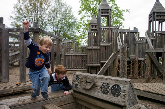 Friends Connor Martin, 4, left, and Ethan Burns, 5, spend and afternoon playing together at Fort Kid.