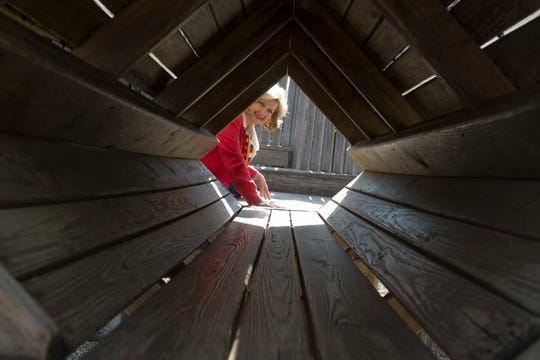 Beth Waters, Fort Kid committee chair looks through the space tunnel.  The Fort Kid playground, adjacent to the Knoxville Museum of Art and World's Fair Park, is going to be renovated in a two-phase project in 2014.