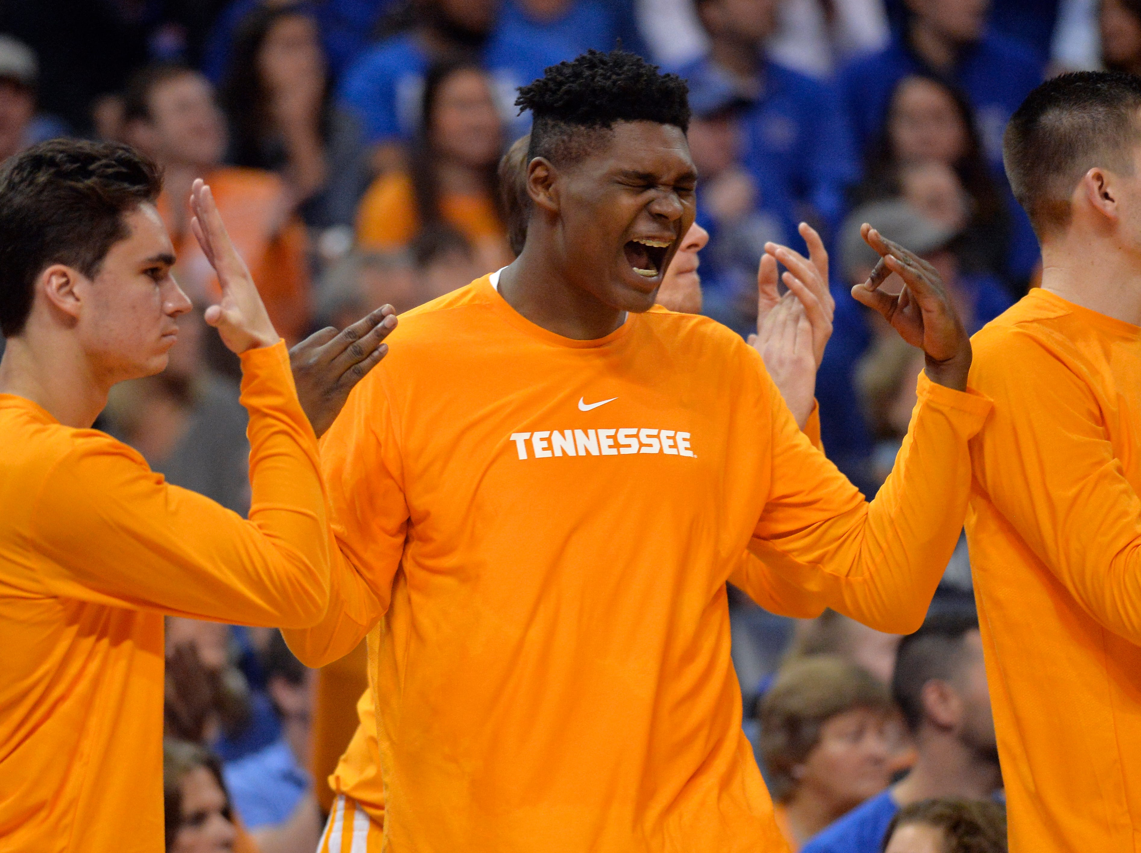 Tennessee forward D.J. Burns, center, reacts from the sideline in the first half of an NCAA college basketball game against Memphis Saturday, Dec. 15, 2018, in Memphis, Tenn.