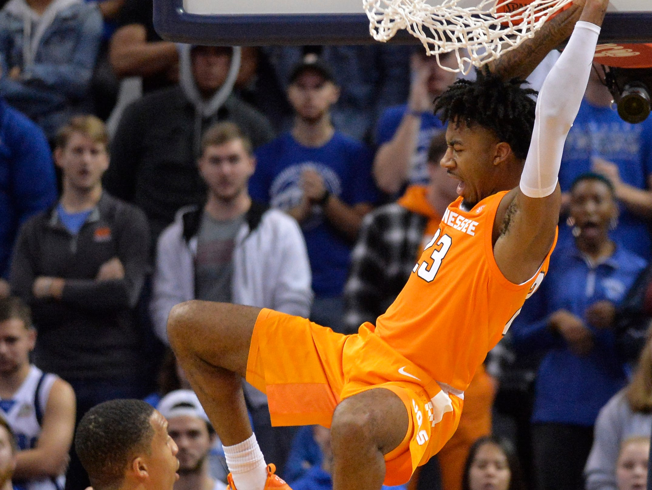 Tennessee guard Jordan Bowden (23) hangs from the rim after dunking the ball in the first half of an NCAA college basketball game against Memphis Saturday, Dec. 15, 2018, in Memphis, Tenn.