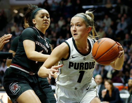 Karissa McLaughlin of Purdue looks to pass as she dribbles through the lane against South Carolina Sunday, December 16, 2018, at Mackey Arena. Purdue lost a heartbreaker to South Carolina 82-73 2OT.