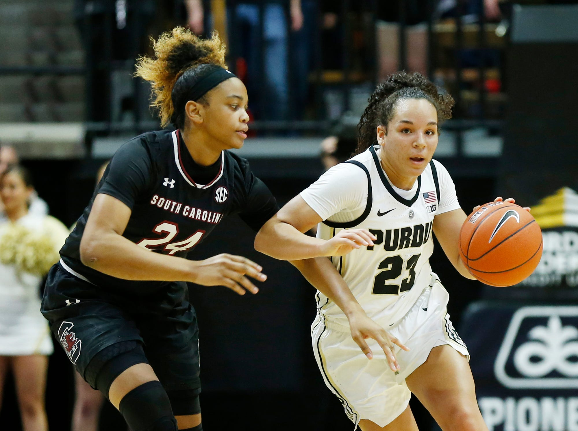 Purdue guard Kayana Traylor is chased by South Carolina's LeLe Grissett.