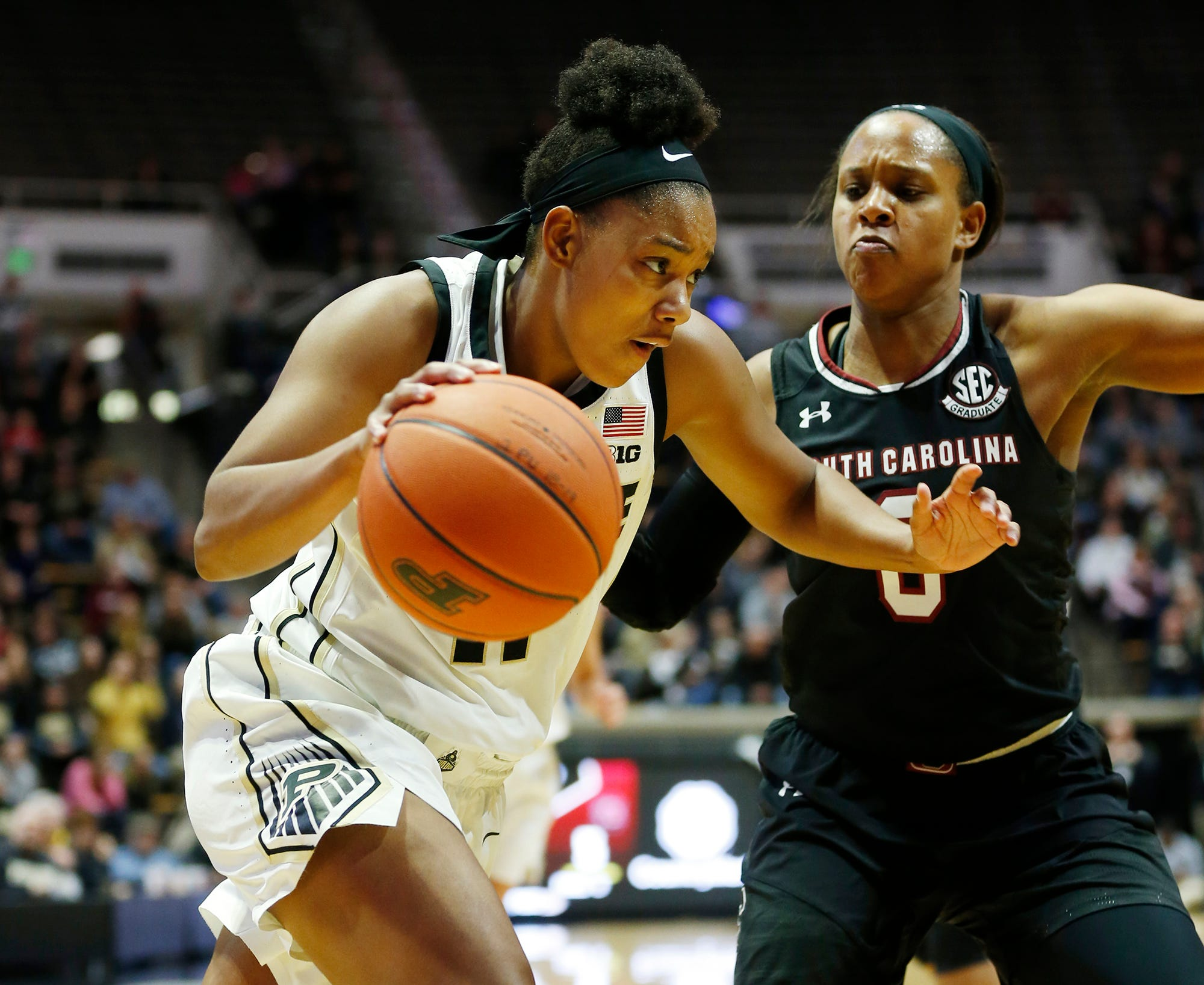 Dominique Oden Purdue with a drive along the baseline against Nelly Perry of South Carolina Sunday, December 16, 2018, at Mackey Arena. Purdue lost a heartbreaker to South Carolina 82-73 2OT.
