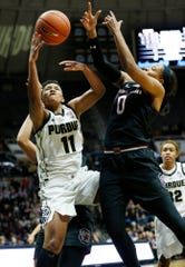 Dominique Oden of Purdue grabs an offensive rebound in front of Nelly Perry of South Carolina Sunday, December 16, 2018, at Mackey Arena. Purdue lost a heart breaker to South Carolina 82-73 2OT.