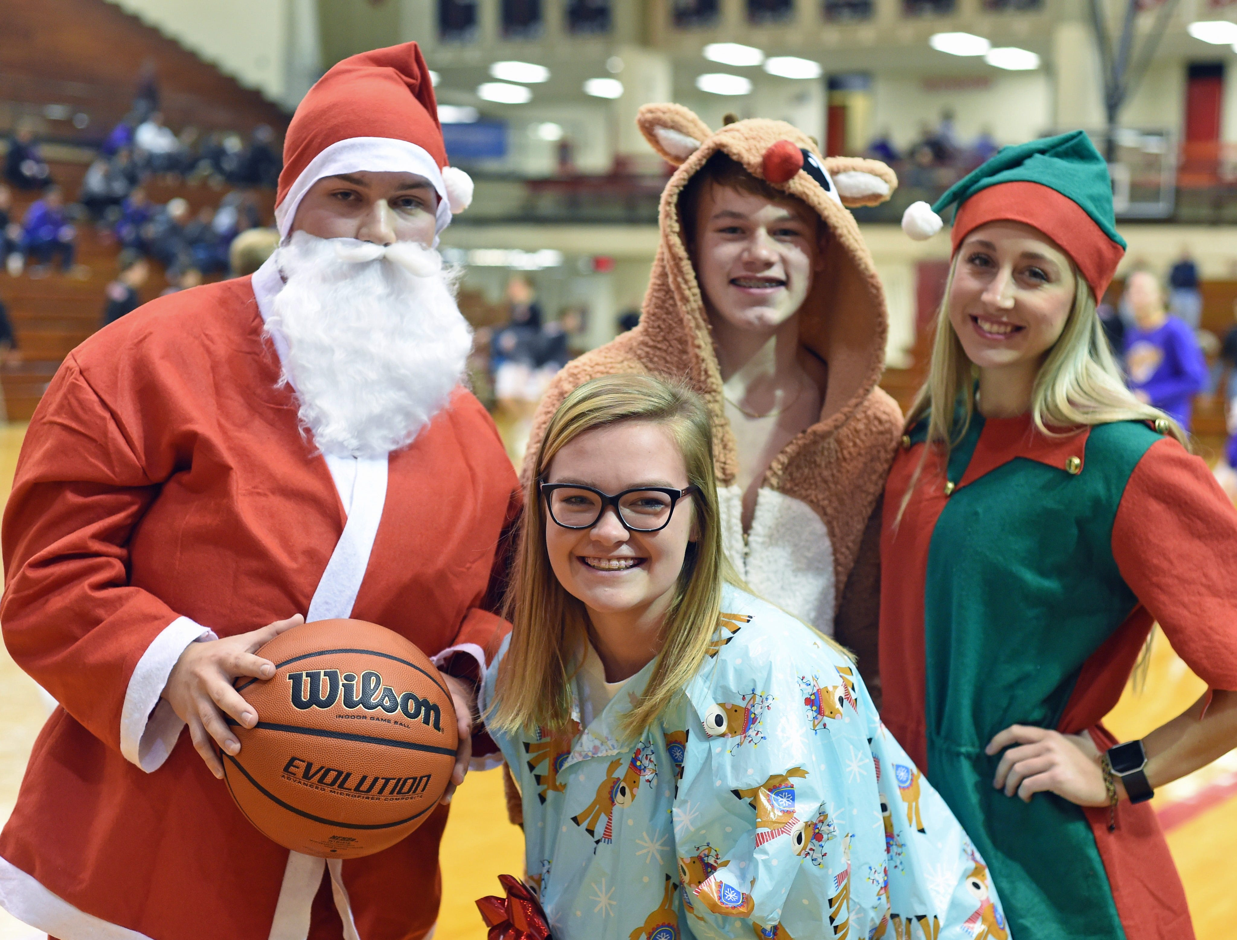 Santa and his North Pole helpers made an early appearance Saturday night to cheer the Lafayette Jeff Bronchos to a win over the Guerin Golden Eagles. Helping Santa out were Nate Franklin, Maddie Jones, Steven Stephany and Emilee Cox.